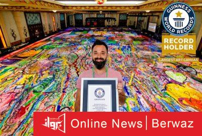 Sasha jefry2 400x269 - رسام بريطانى يدخل موسوعة جينيس برسم أكبر لوحة فنية فى دبى