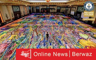 Sasha jefry3 400x252 - رسام بريطانى يدخل موسوعة جينيس برسم أكبر لوحة فنية فى دبى